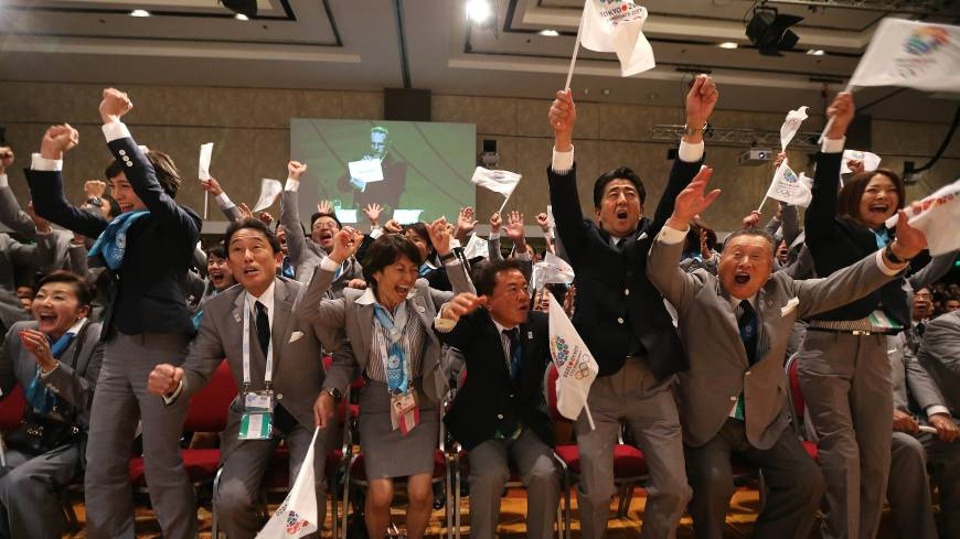 Prime Minister Shinzo Abe (third from right) celebrates alongside Tokyo 2020 delegation members as IOC president Jacques Rogge announces the Japanese capital as the winner of the bid to host the 2020 Summer Olympic Games, during the 125th session of the International Olympic Committee, in Buenos Aires on Sept. 7.