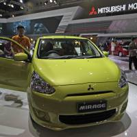 Kicking the tires: An attendee checks out at a Mitsubishi Motors Corp. Mirage displayed at the Indonesia International Motor Show in Jakarta on Sept. 20, 2012. | BLOOMBERG