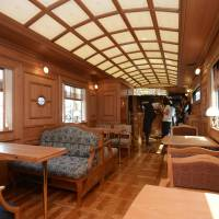 Wood on wheels: Luxury cars, including this dining car, for Kyushu Railway Co.'s new Seven Star sleeper train are unveiled to the media in Kitakyushu on Friday. | KYODO