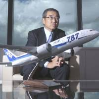 Decision-maker: Shinichiro Ito, president and chief executive officer of ANA Holdings Inc., speaks behind a model of a Boeing Co. 787 Dreamliner for ANA during an interview in Tokyo on Sept. 4. | BLOOMBERG
