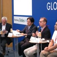 Signs of change: Robert Alan Feldman (second from right), managing director at Morgan Stanley MUFG Securities, speaks during a panel discussion at the G1 Global Conference at Globis University in Tokyo on Monday. | KAZUAKI NAGATA