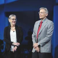 All in the family: Alice Walton and Jim Walton, chairman and chief executive officer of Arvest Bank Group Inc., smile during the Wal-Mart Stores Inc. annual shareholders meeting in Fayetteville, Arkansas. The Waltons, America's richest family, exploit a variety of legal loopholes to avoid the estate tax, according to court records and Internal Revenue Service filings. | BLOOMBERG