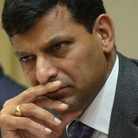 Rajan's war on inflation puts onus on Singh