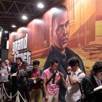 Big fish in a strange pond: Visitors line up to check out the latest version of 'Grand Theft Auto,' which will be released in the domestic market next month, at the Tokyo Game Show in Chiba Prefecture on Thursday. | AFP-JIJI