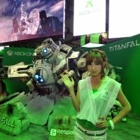 A model shows off the 'Titanfall' display at Microsoft's Xbox One booth. | YOSHIAKI MIURA