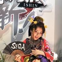 A model advertises Sega's 'Yakuza Ishin,' which launches in February 2014. | YOSHIAKI MIURA
