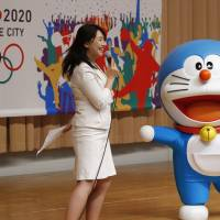 Star power: Doraemon, one of Japan's most popular animation characters, participates in a kick-off ceremony on Aug. 23 in aid of Tokyo's bid to host the 2020 Olympics. | AP