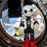 Hello Earthlings: The humanoid robot Kirobo, seen in this handout photo taken Aug. 21 and released Thursday from 2013.KIBO-ROBOT, speaks aboard the International Space Station. The pint-size android has uttered the first robotic words in space, showcasing Japan's drive to combine cutting-edge technology with cuteness. | AFP / 2013.KIBO-ROBOT