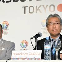 Off message: Japanese Olympic Committee President Tsunekazu Takeda (right) and Fujio Cho, president of the Japan Sports Association, attend a media event Wednesday in Buenos Aires, where they hoped to pitch Tokyo's 2020 Olympics bid. Instead, they were bombarded with questions about radiation from the Fukushima No. 1 plant. | KYODO