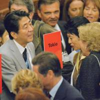Crunch time: Prime Minister Shinzo Abe chats with Princess Hisako of Takamado after a meeting of the International Olympic Committee in Buenos Aires on Friday. | KYODO