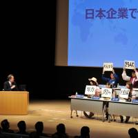 In a word: Moderator Akira Ikegami asks eight panelists what in their view is the most impressive feature of Japanese corporate culture at a symposium in Tokyo on Saturday. | YOSHIAKI MIURA