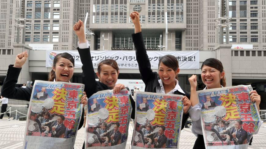 Thrilled: College students, showing their excitement that Tokyo was chosen to host the 2020 Olympic Games, hold up four-page extra editions of Sports Nippon newspaper on Sunday morning outside of the Tokyo Metropolitan Government Building in Shinjuku Ward. Other newspapers also distributed free commemorative editions in Tokyo.