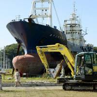 Work starts to scrap beached ship
