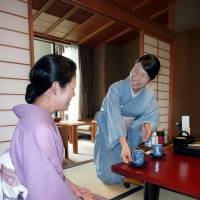 What's my line?: Iku Sakurabe (right), a graduate of Kyoto Seika University who studied cartooning, is trained by a supervisor how to serve tea at the luxury Nakanobo Zui-en inn in Kobe on July 18. | KYODO