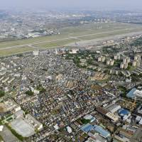 No-fly zone: U.S. Yokota Air Base, situated near the city of Fussa in western Tokyo, is seen in 2009. | KYODO