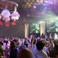 The high life: Some 2,000 men and women dance at an event in Tokyo hosted by the Grand Prince Hotel New Tanakawa in Minato Ward in August, recalling the disco craze that swept Japan during the 'bubble' years. | KYODO
