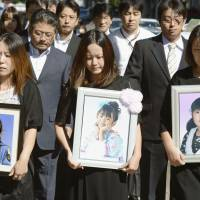 Judgment: Mothers of girls killed when their school bus was swamped by the 2011 tsunami enter the Sendai District Court on Tuesday. The court ordered the kindergarten that operated the bus to pay ¥177 million in damages. | KYODO