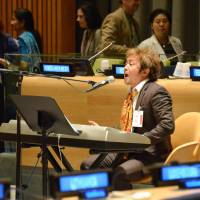 Positive path: Singer Shinji Harada performs at the United Nations in New York on Sept. 6 as part of a high-level forum on the Culture of Peace. | KYODO
