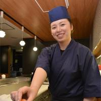 Meal ticket: Yu Shimono, who is enrolled in the Tokyo Sushi Academy's one-year course and training under chef Toshio Ogiwara, hones her sushi skills July 23. | KYODO
