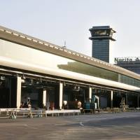 Walk this way: New moving walkways at Narita International Airport that connect Terminal 2 and an annex will begin service next Friday, replacing the highly unpopular bus service. | KYODO