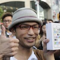 Apple's two latest iPhone models hit shelves in Japan