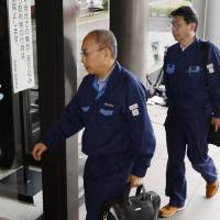 Crack down: Members of an inspection team from the transport ministry enters Hokkaido Railway Co.'s headquarters Tuesday morning to look into the railway's failure to address problems with its tracks.   | KYODO