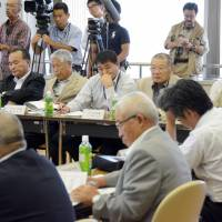 Testing the waters: Members of the Fukushima Prefectural Federation of Fisheries Cooperative Associations attend a meeting Tuesday in the city of Fukushima on resuming operations. | KYODO