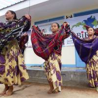 Dancing with joy: Students perform a traditional B'laan tribal dance during the handover of a Japanese-funded school building in the village of San Jose, the Philippines, on Sept. 17. | KYODO