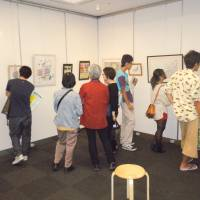 The view inside:  Visitors take in paintings by death-row inmates during a special exhibition of their works Saturday at Shibuya Cultural Center Owada in Tokyo. | TOMOHIRO OSAKI