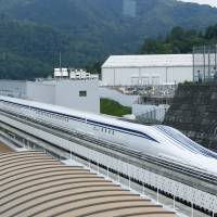 Straight ahead: Central Japan Railway Co.'s magnetically levitated train is put through a test run in Tsuru, Yamanashi Prefecture. | KYODO