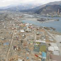 The city of Ofunato, Iwate Prefecture, is seen on March 19, 2011, after the 3/11 disasters wiped swaths of it off the map, and on Friday, around 2½ years later. 