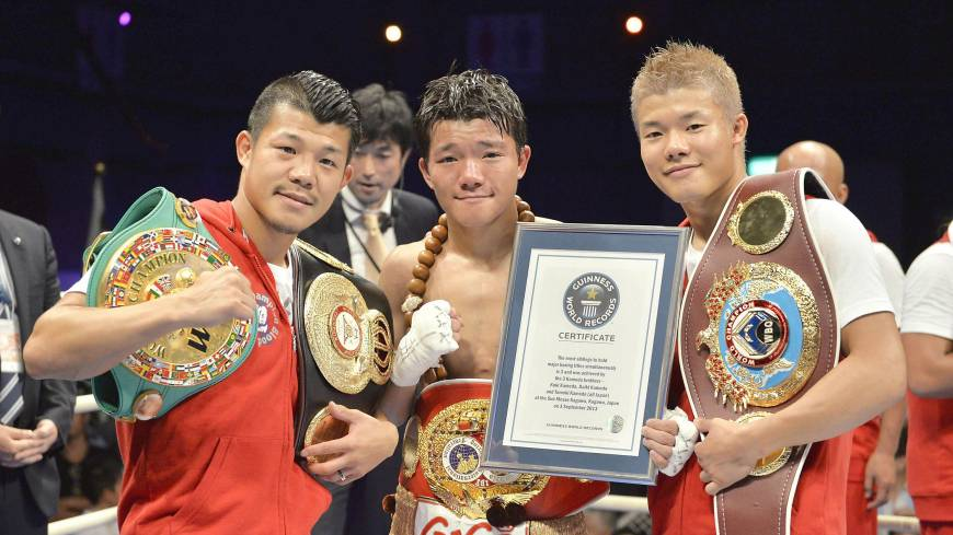 Daiki Kameda (center) poses with brothers Koki (left) and  Tomoki after beating Rodrigo Guerrero on  Tuesday to win the IBF super-flyweight title. The Kamedas are the first trio of brothers to hold world titles at the same time.