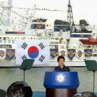 Anchors aweigh: South Korean President Park Geun-hye speaks at a ceremony celebrating the launch of a new coast guard vessel to patrol around the pair of islets it controls that are claimed by Japan.  | KYODO