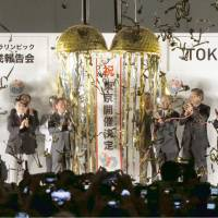 Bringing home the gold: People involved in Tokyo's winning bid to host the 2020 Olympics celebrate Tuesday evening at the Tokyo Metropolitan Government office in Shinjuku Ward.  | KYODO