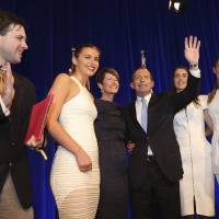 Uninvited guest: An anti-coal activist intrudes on Australian Prime Minister-elect Tony Abbott and his family as they celebrate the conservative leader's election victory in Sydney on Saturday. | AFP-JIJI