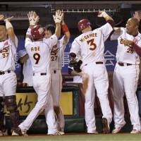 Winning spirit: The Tohoku Rakuten Golden Eagles, celebrating their three-run comeback in the eighth inning, defeat the Seibu Lions 4-3 on Tuesday. | KYODO