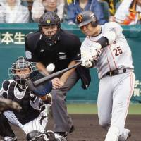 Textbook swing: Giants slugger Shuichi Murata hits a two-run homer against the Tigers in the fourth inning on Saturday at Koshien Stadium. Yomiuri defeated Hanshin 4-1. | KYODO