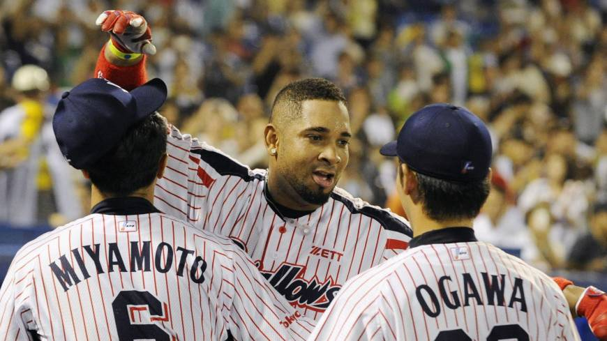 Brotherly love: Wladimir Balentien is congratulated by teammates Shinya Miyamoto and Yasuhiro Ogawa after breaking the single-season home run record on Sunday.