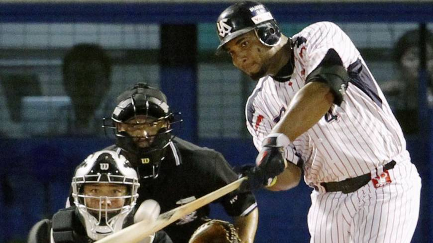 One more for luck: Wladimir Balentien extends his newly minted single-season home run record with his 57th of the year at Jingu Stadium on Sunday.