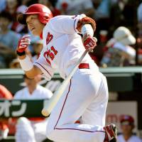 Carp beat Giants to boost playoff hopes