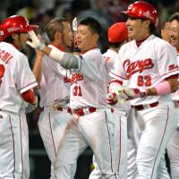Catch of the day: The Carp celebrate during their 2-1 win over the Tigers on Tuesday at Mazda Stadium in Hiroshima. | KYODO