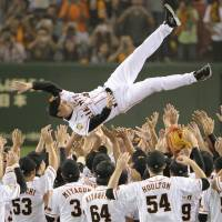 Don't drop me: Yomiuri Giants manager Tatsunori Hara is tossed into the air as his team celebrates winning the Central League pennant on Sunday at Tokyo Dome. | KYODO