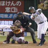 Let's go home: Seibu's Esteban German hits a sayonara single in the ninth to give the Lions a 4-3 win over the Eagles on Tuesday. | KYODO