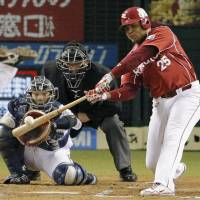 First time for everything: Tohoku Rakuten's Andruw Jones hits a two-out, bases-loaded double in the seventh inning of the Golden Eagles' 4-3 win over the Lions on Thursday night. | KYODO