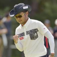 Flying start: Shingo Katayama celebrates after sinking a birdie on the 18th hole at the Asia-Pacific Panasonic Open on Thursday. | KYODO