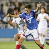 Fujita hat-trick sends Marinos through