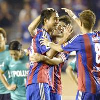 Head first: FC Tokyo's Sota Hirayama (center) takes the plaudits from his teammates after scoring a 90th-minute winner against Urawa Reds on Saturday. Tokyo won 3-2. | KYODO