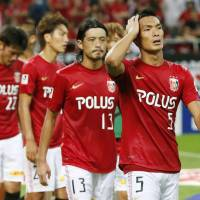 Not enough: The Urawa Reds leave the pitch after a 1-1 draw against Ventforet Kofu on Saturday. | KYODO
