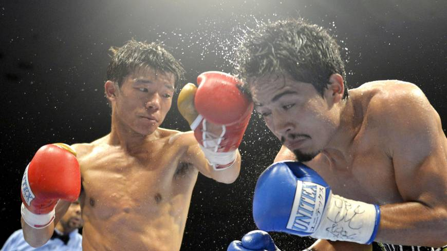 Nowhere to run: Daiki Kameda punches opponent Rodrigo Guerrero during the eighth round of their IBF super flyweight world title bout on Tuesday in Takamatsu. Kameda claimed the vacant title by unanimous decision.
