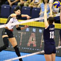 Strong return: Japan's Yuki Ishii spikes the ball against Australia in an Asian qualifying match for the 2014 FIVB World Championships at Park Arena Komaki on Saturday. Japan beat Australia in straight sets. | KYODO